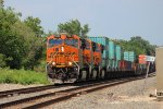BNSF 7854 leads another export stack train westbound.